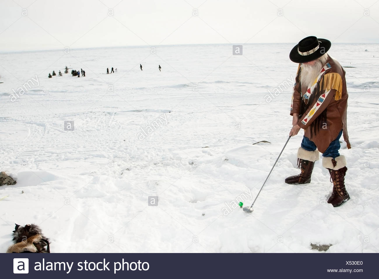 male golfer dressed in skin attire tees off during the bering sea