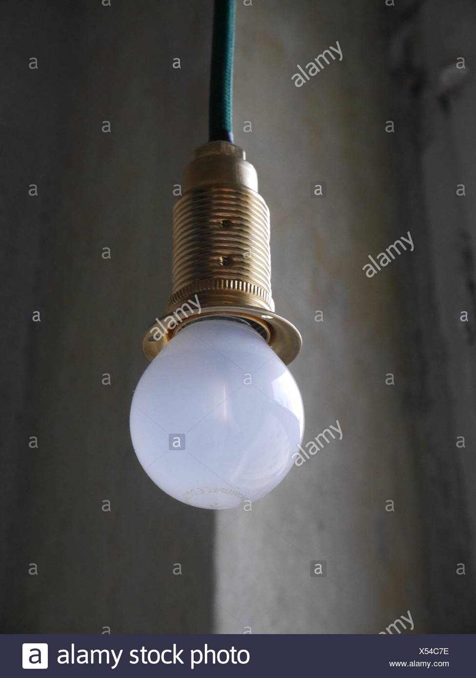 Low angle view of white light bulb hanging from ceiling stock photo low angle view of white light bulb hanging from ceiling aloadofball Image collections