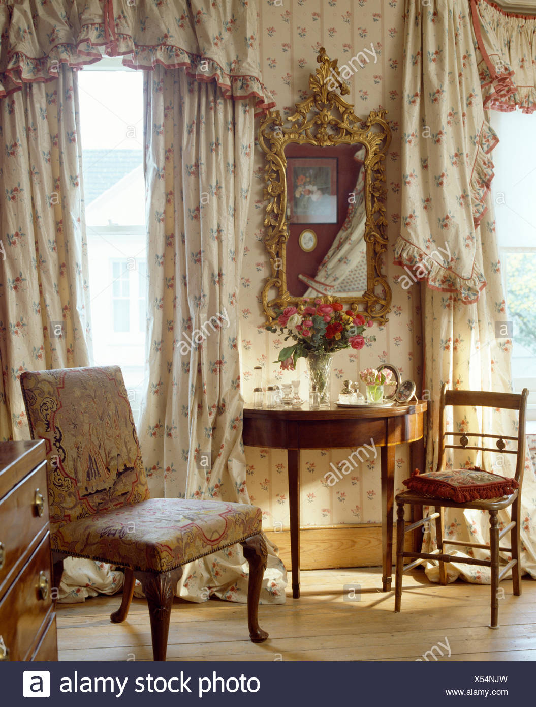 Floral Curtains And Pelmet On Windows In Bedroom With Antique Gilt Mirror  Above Antique Console Table
