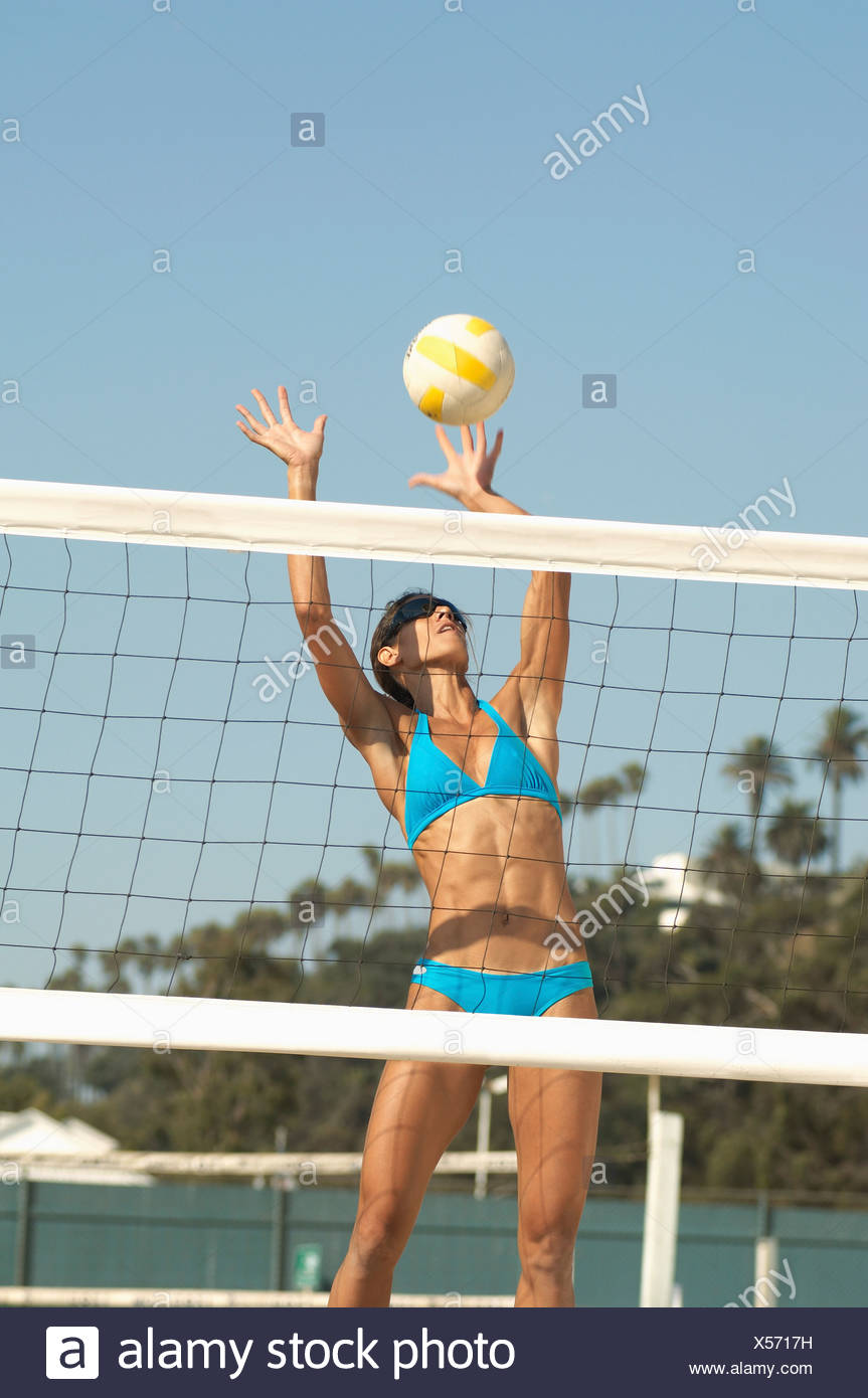 Happy friends playing volleyball on beach stock photo image of.