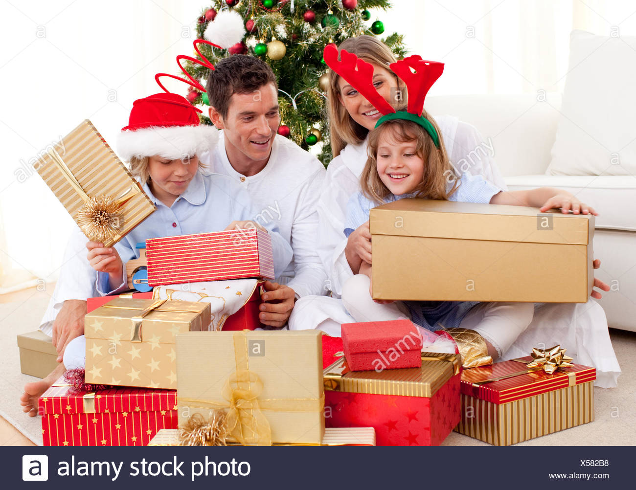 Young family having fun with Christmas gifts Stock Photo: 278616668 ...