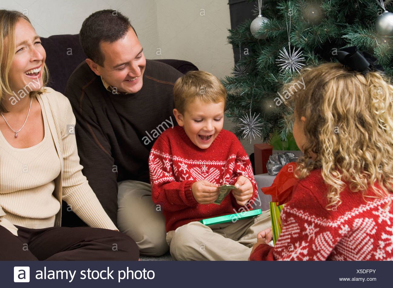 Family opening Christmas gifts Stock Photo: 278736947 - Alamy