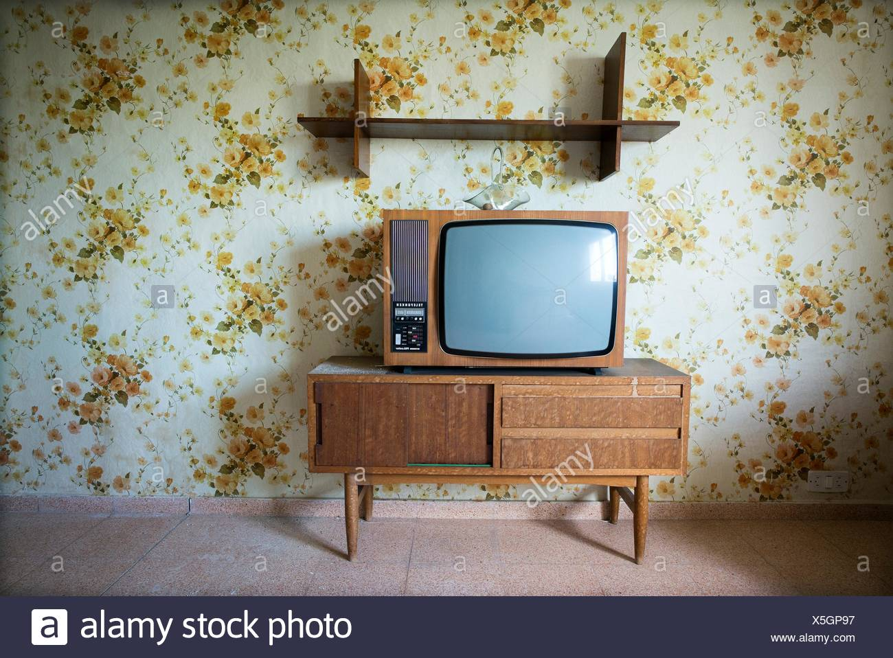 Vintage Living Room With A Floral Wallpaper In The Wall And Ta TV On Top Of Cabinet Mao Mahon Menorca Biosphere