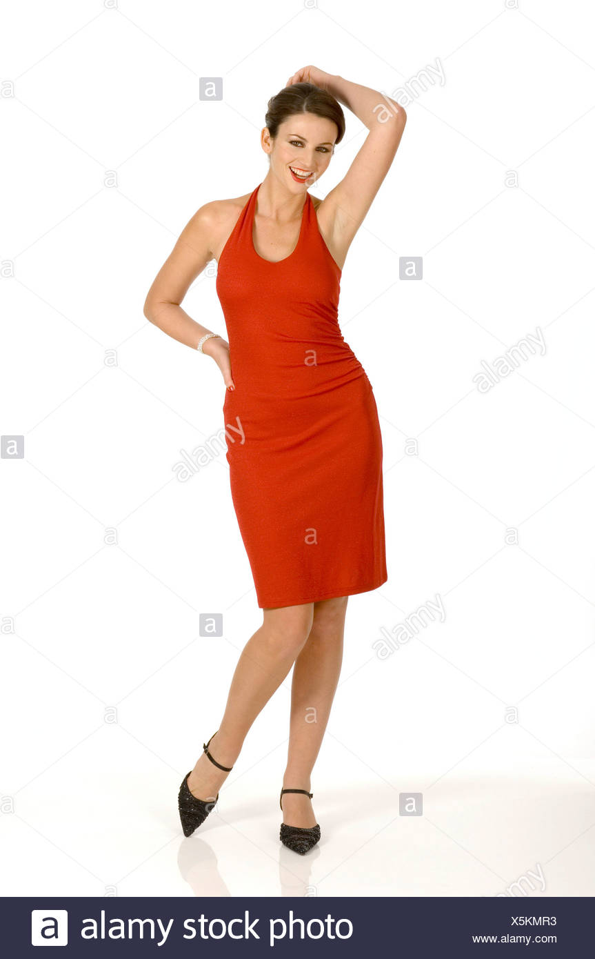 cc131503e48 Female brunette hair tied up wearing short red halterneck dress black  strappy sandals Standing hand on hip