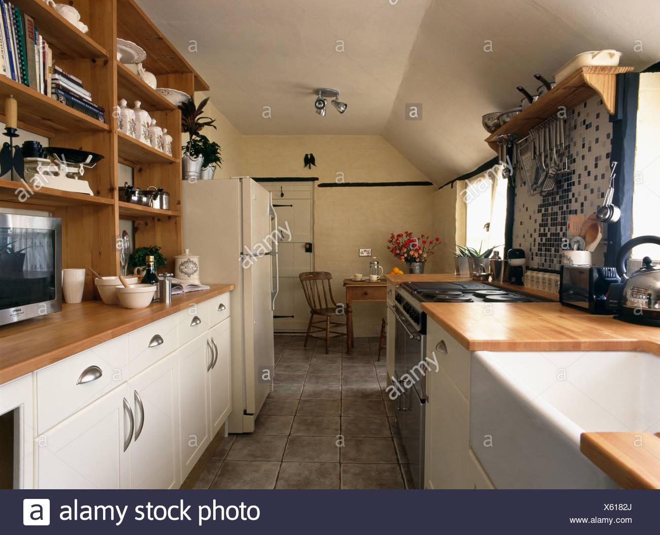 Belfast sink in traditional galley kitchen with cream ed units ... on open galley kitchen remodel, stove kitchen design ideas, walk in closet design ideas, white galley kitchen design ideas,