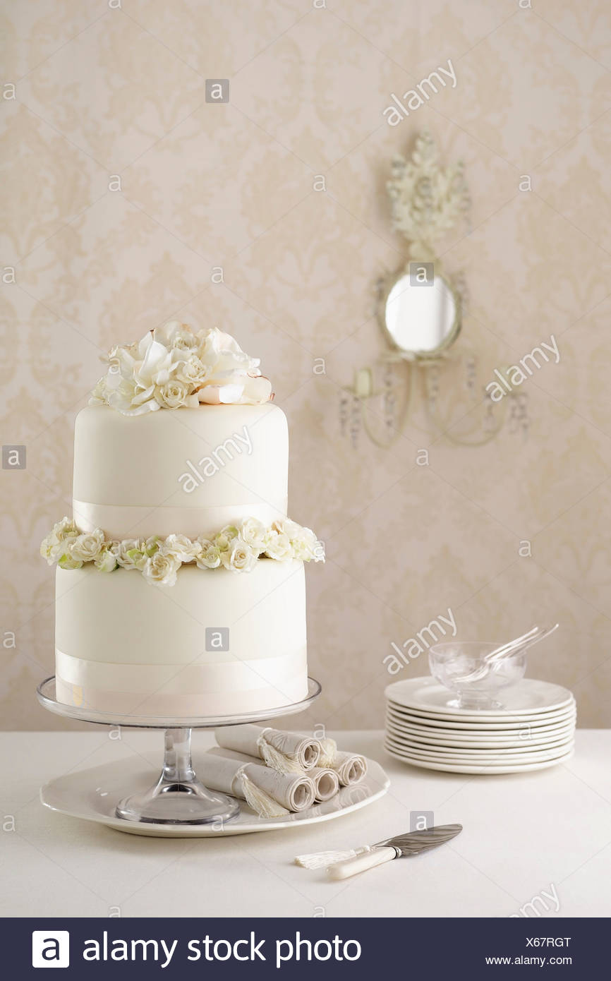 Two tier wedding cake with knife and plates stock photo 279225992 two tier wedding cake with knife and plates junglespirit Choice Image