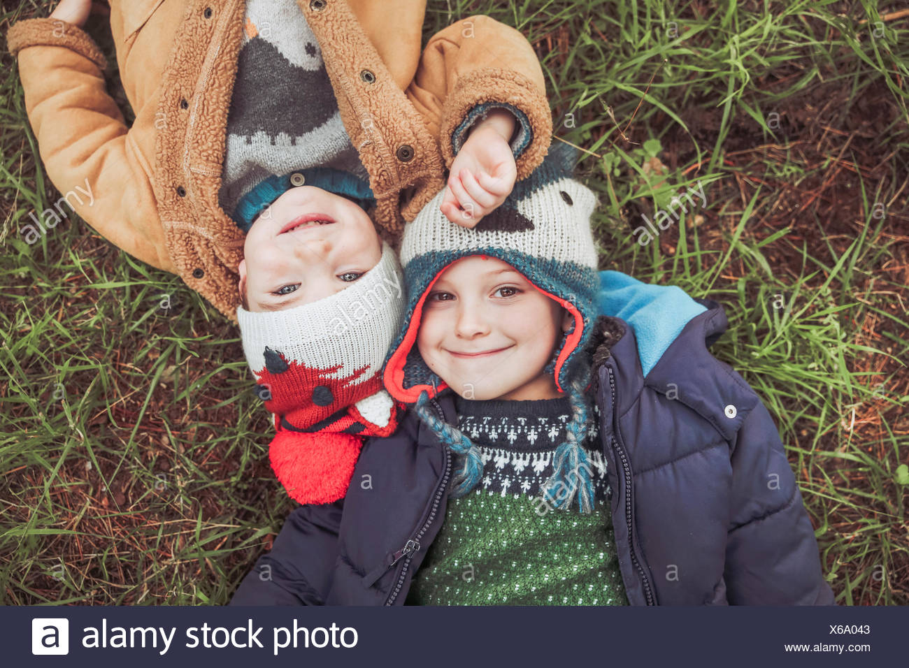 Two boys wearing wooly hats lying in grass Stock Photo  279273459 ... f6e266e72888