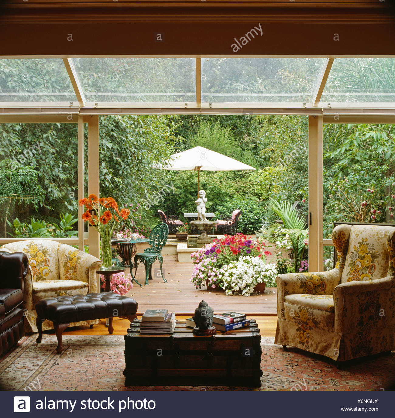 Armchairs In Glass Conservatory Living Room Extension With Sliding