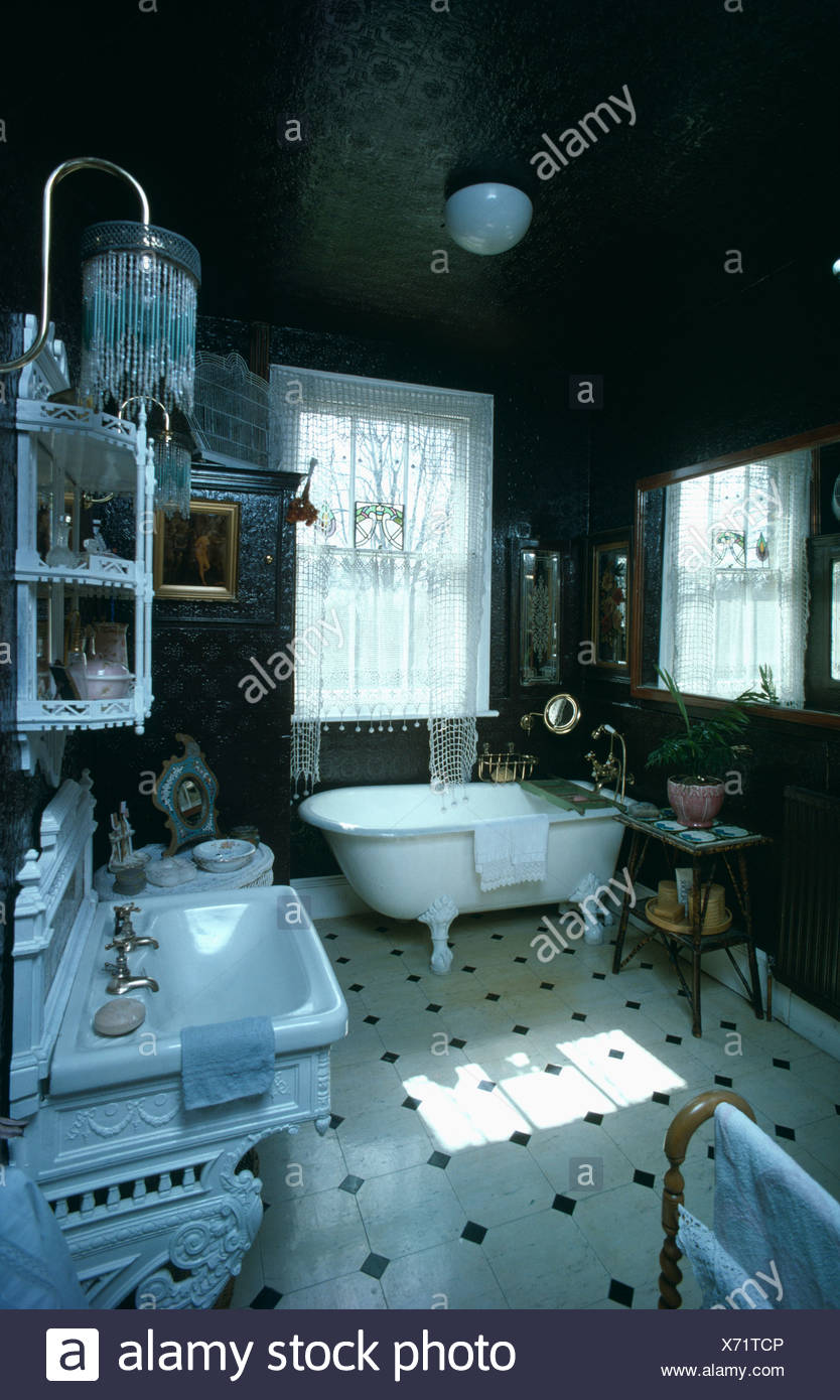 Freestanding bath in Victorian bathroom with black and white tiled ...