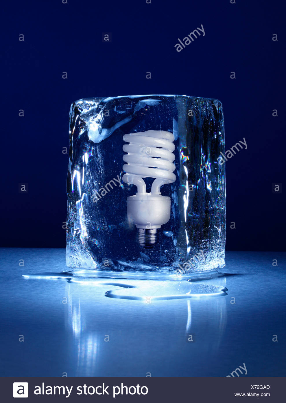 large block of ice with a compact light bulb frozen inside stock