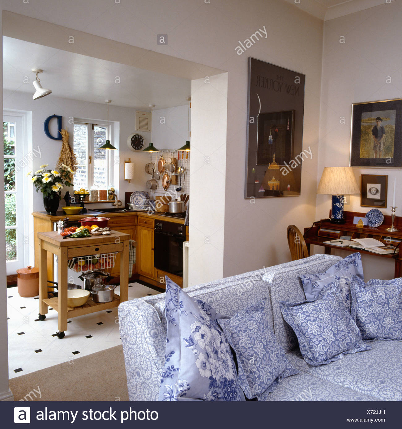 Blue And White Floral Patterned Settee In Small Apartment With Kitchen  Extension