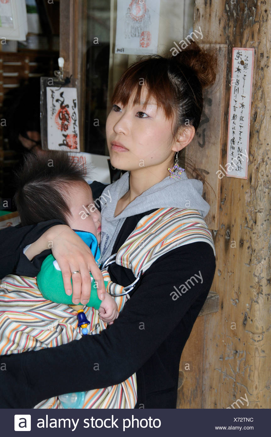Young Japanese Woman Holding A Baby Kyoto Japan Asia Stock Photo