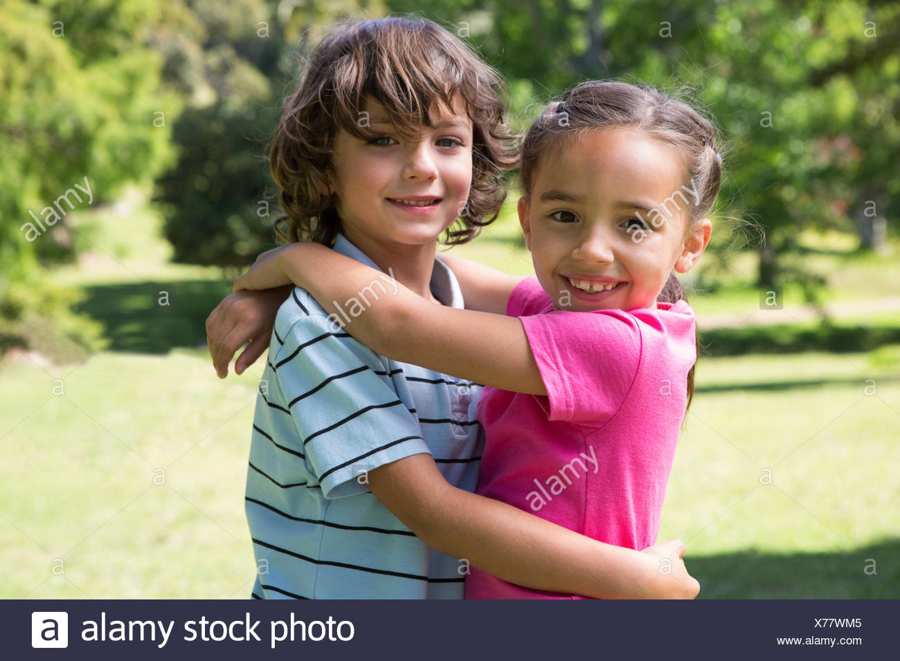 little siblings hugging each other stock photo 279842309 alamy