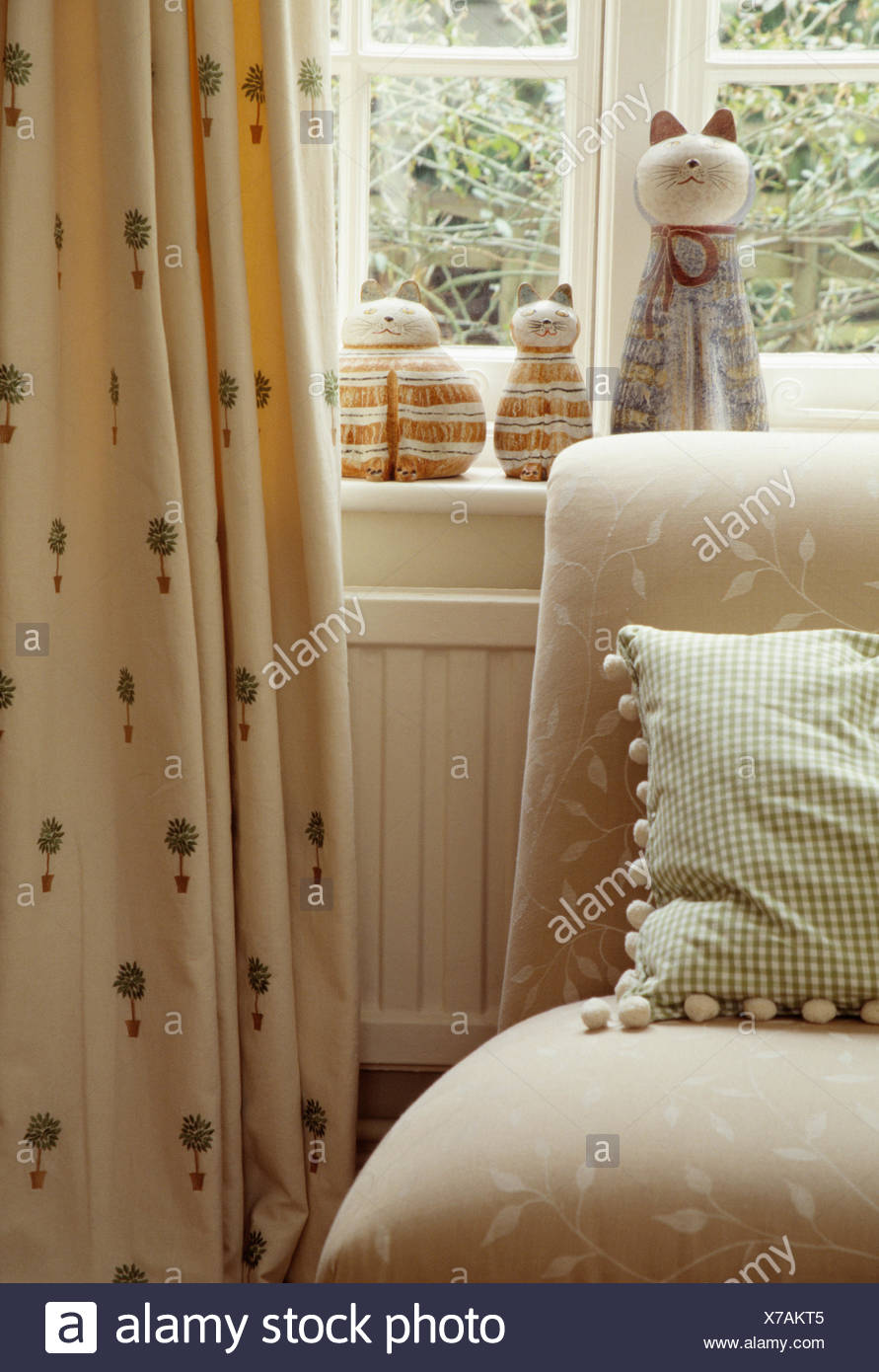 Exceptional Close Up Of Bobble Edged Cushion On Beige Sofa In Front Of Window With  Cream Topiary Patterned Curtains
