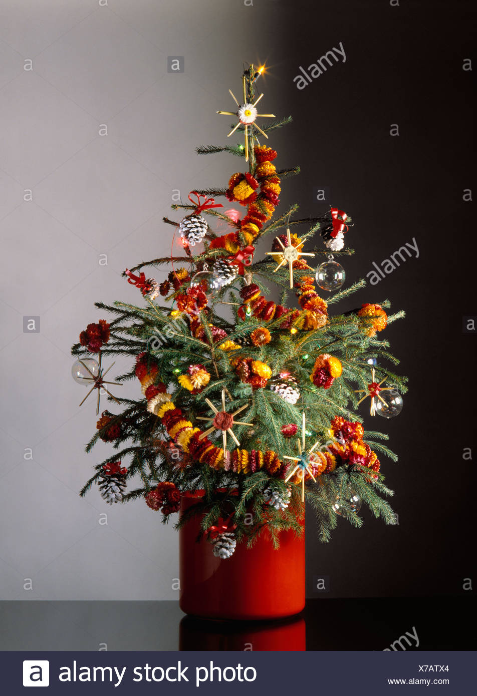 christmas tree decorated with natural decorations of corn stars chains of dried flowers and pine cones