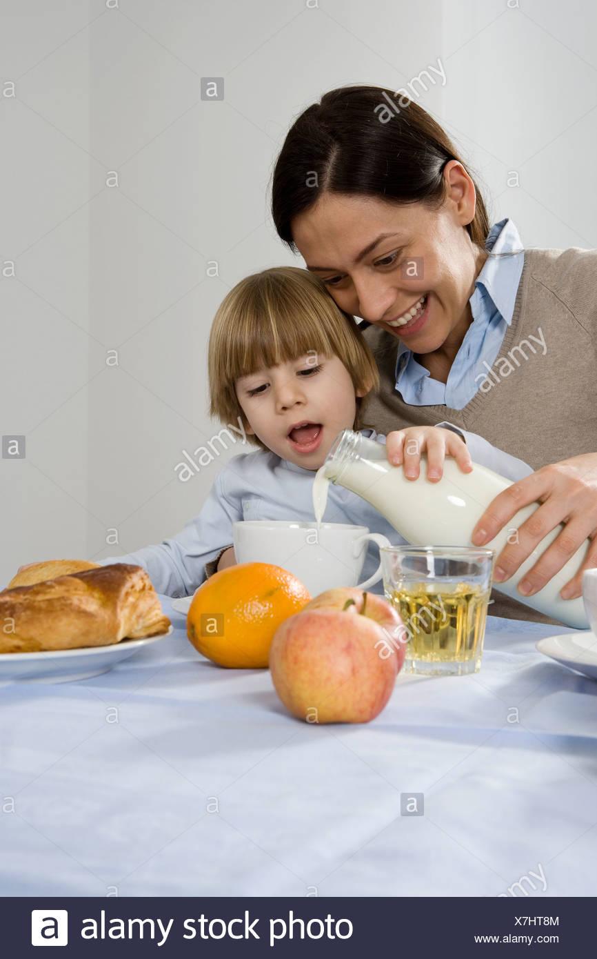 Mom milking son