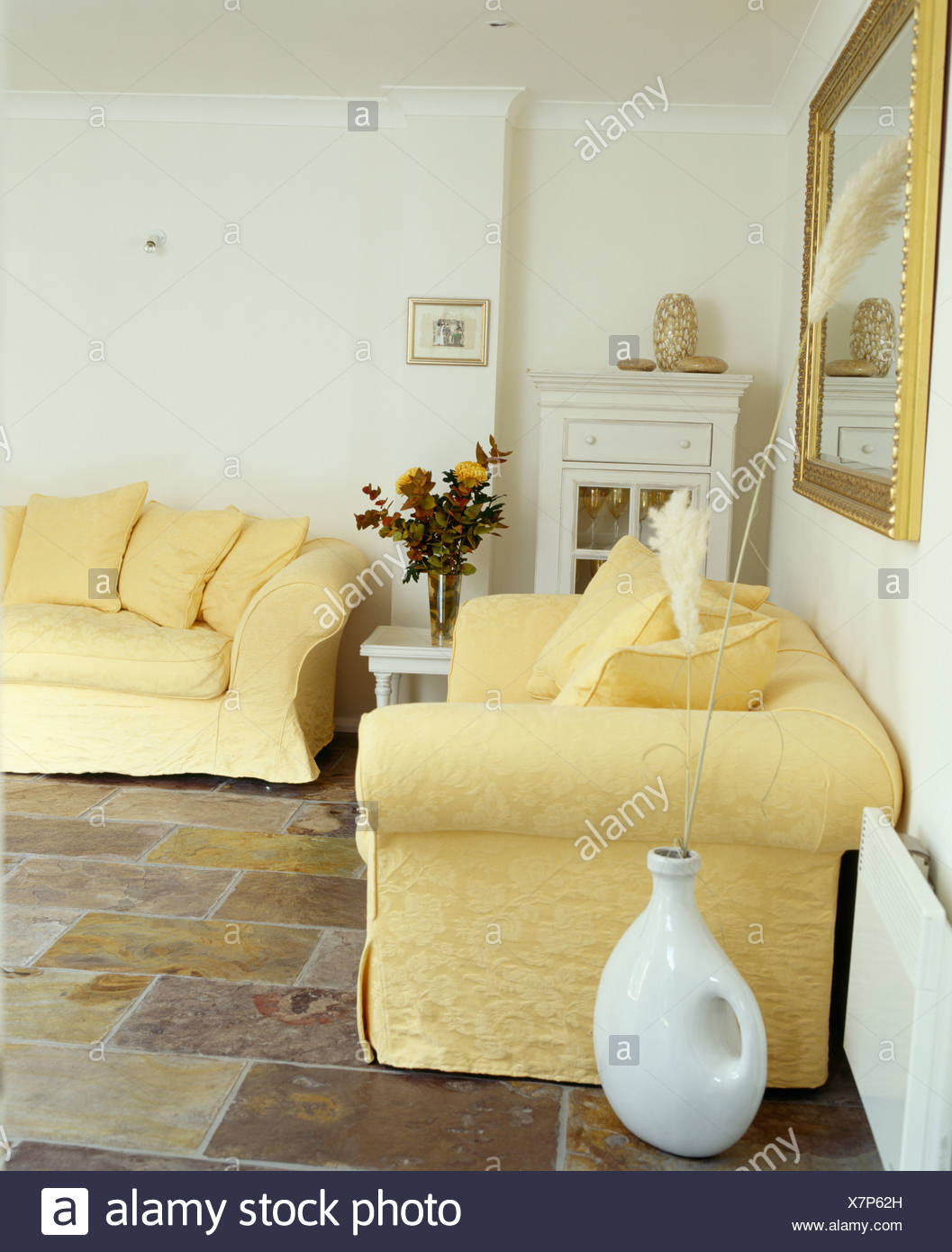 Pale Yellow Sofas In White Living Room With Slate Floor Tiles