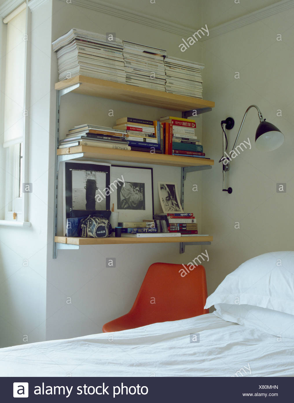 wall lamp beside bookshelves corner of bedroom above bed - Bookshelves Around Bed