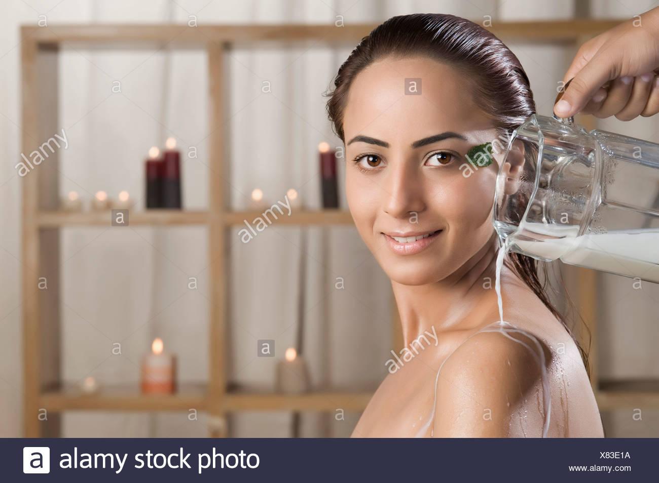 Woman taking a milk bath in a health spa Stock Photo: 280360006 - Alamy