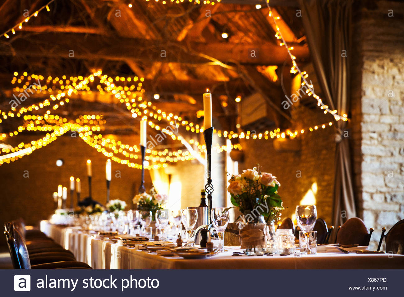 A Wedding Venue Decorated For A Party With Fairy Lights And The