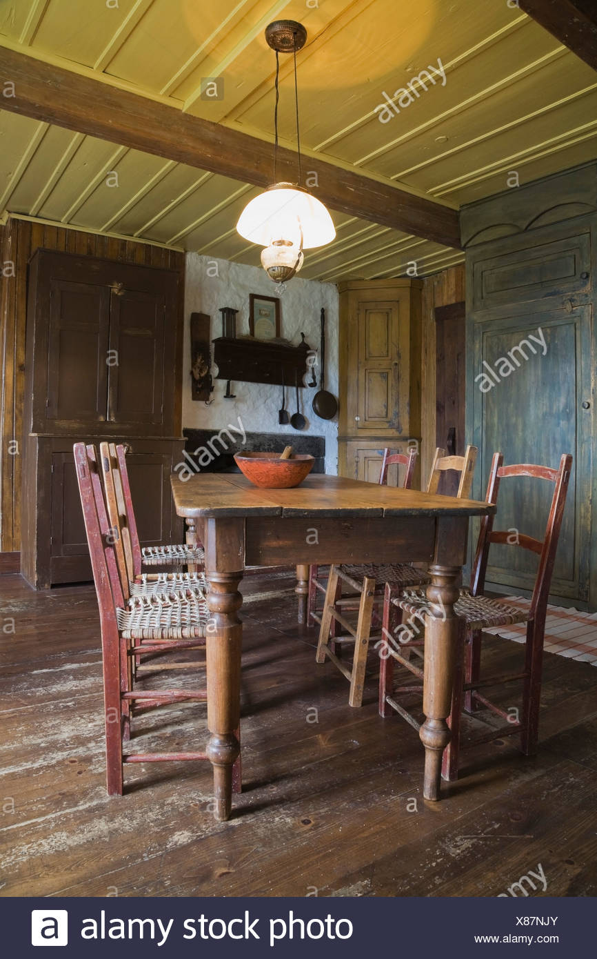 Antique dining table and chairs in 19th century home, Quebec, Canada - Antique Dining Table And Chairs In 19th Century Home, Quebec, Canada
