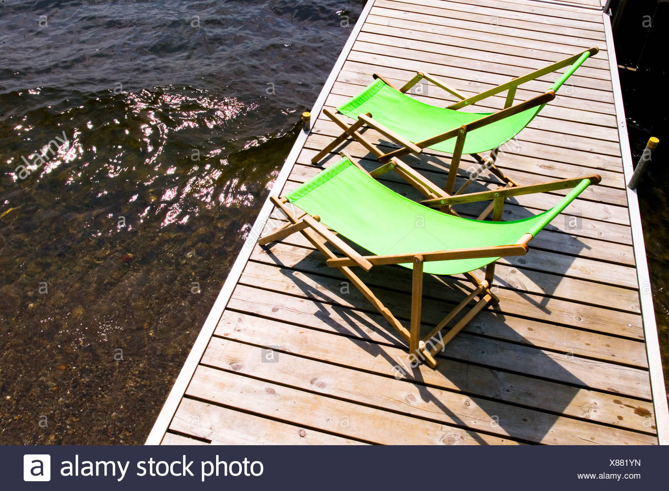 Green Sun Chairs On A Boat Dock, North Hatley, Quebec, Canada