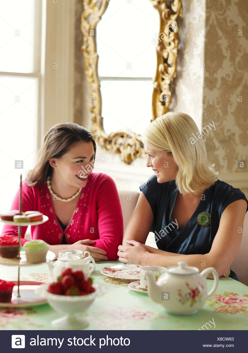 Two young women sitting at dining table Stock Photo  280566331 - Alamy 4be4eb04c