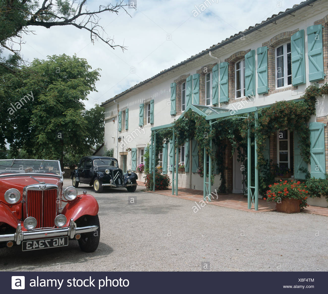 Red Mg And Black Citroen Cars Outside French Country House With