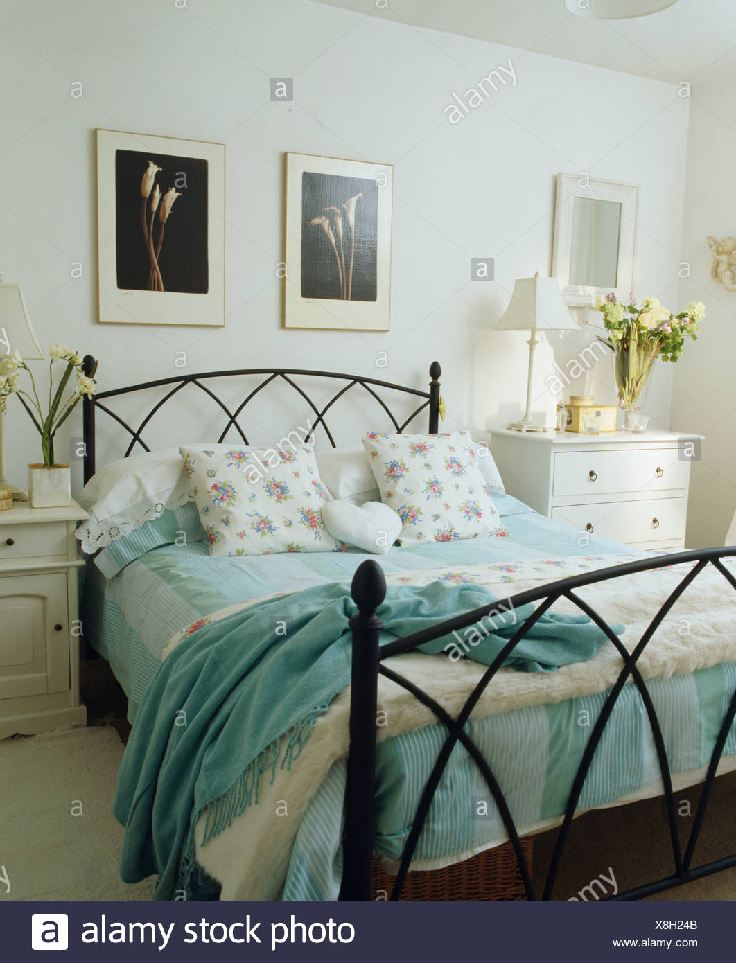 turquoise wool throw on wrought iron bed with turquoise striped rh alamy com