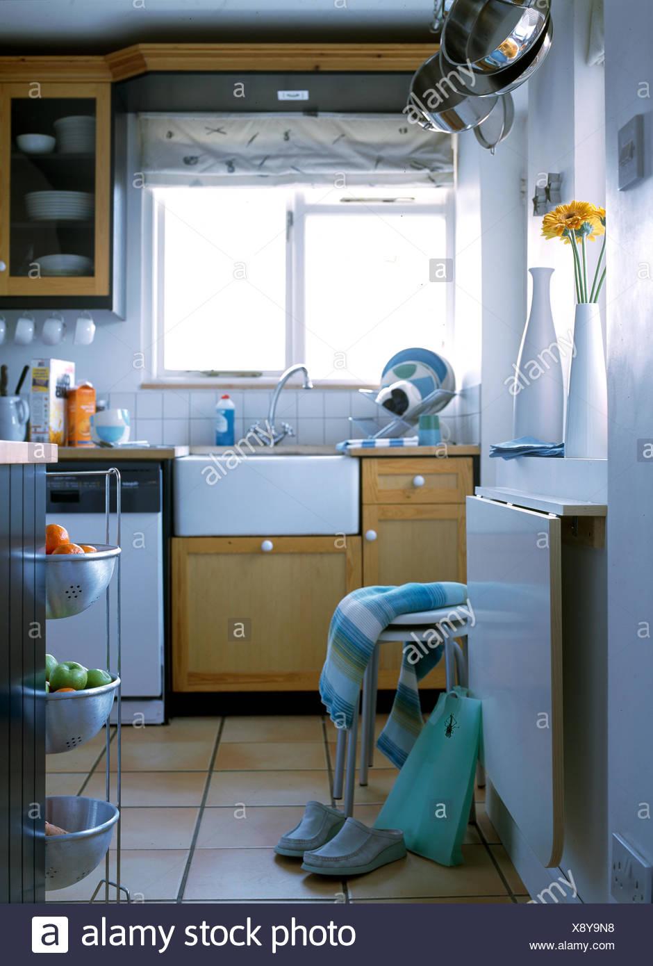 Butler\'s sink in unit below window in small kitchen Stock Photo ...