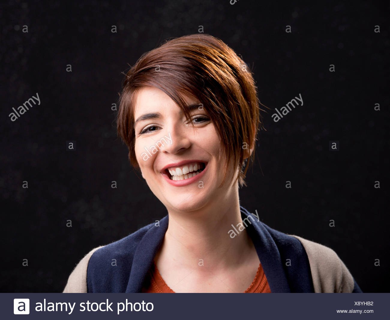 Portrait Of A Beautiful Woman Laughing And With A Modern Hair Cut