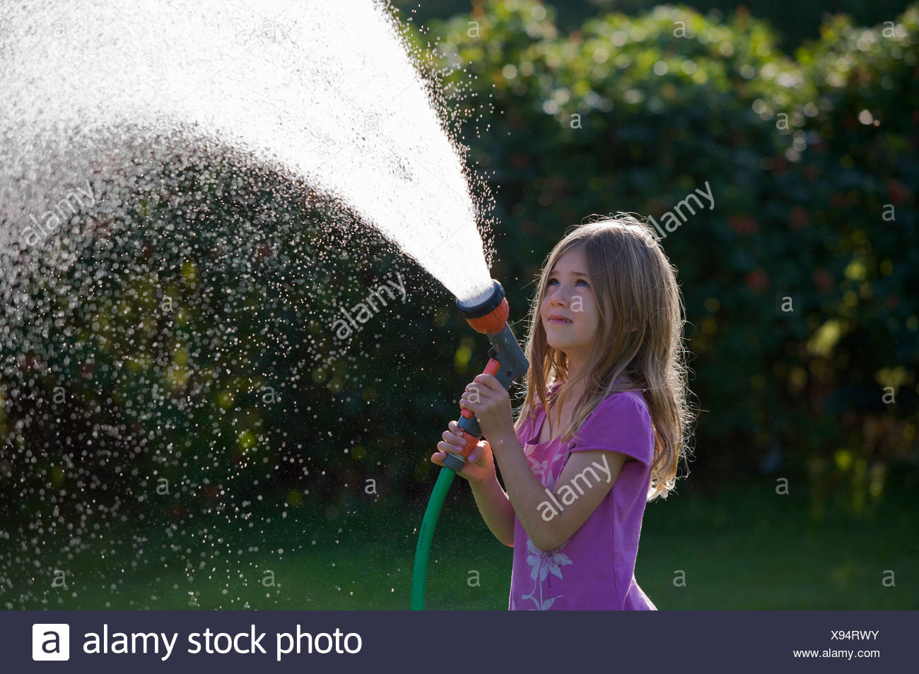 Girl with water hose