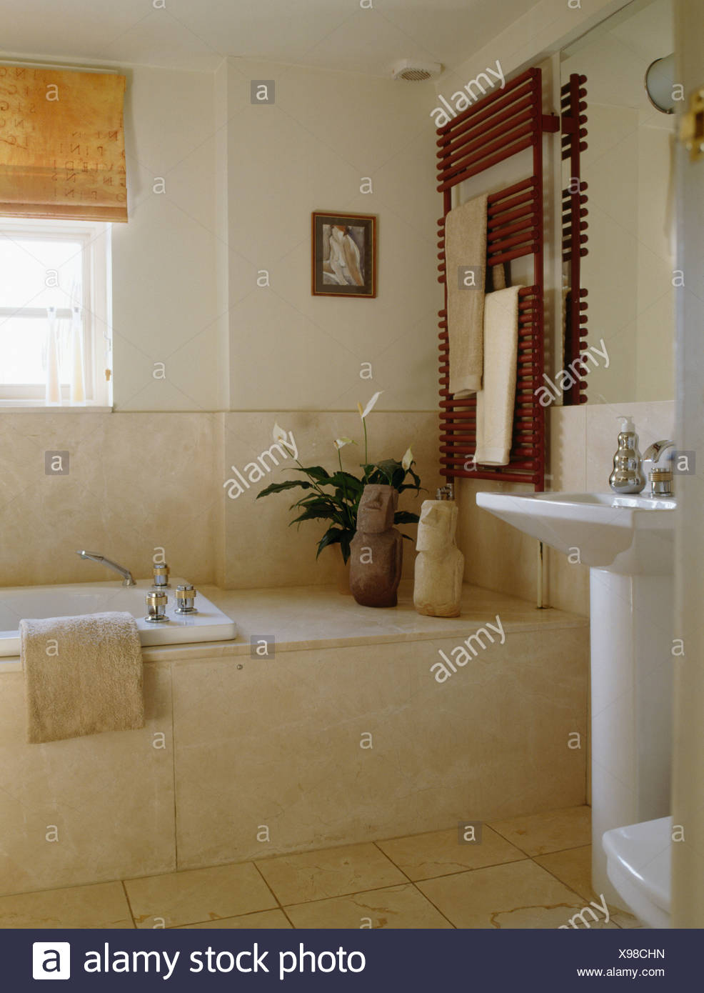 Marble Tiled Bath Panel And Wall Tiles In Cream Bathroom With Wall Mounted  Radiator On Wall Above Bath