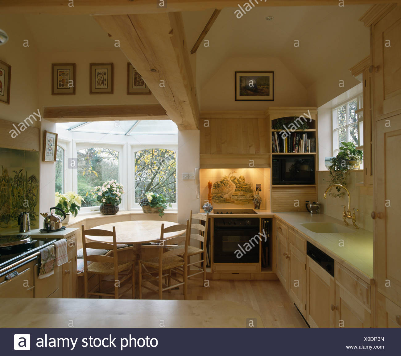 Oven In Lighted Alcove Country Kitchen With Circular Wooden Table Window Of Small Diningroom