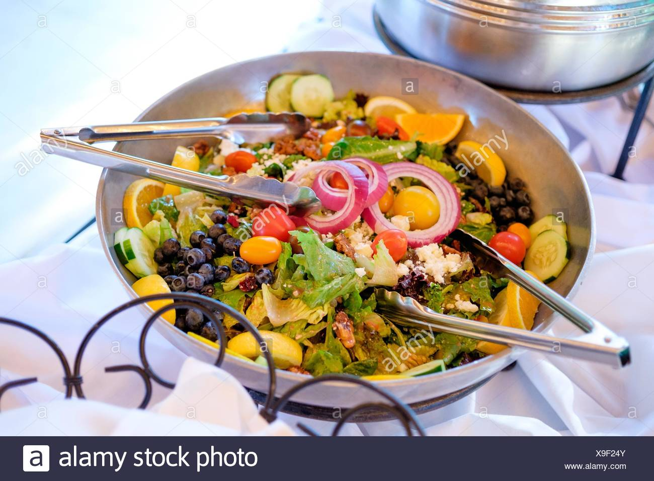 House Salad On A Buffet Table At An Outdoor Wedding Reception In