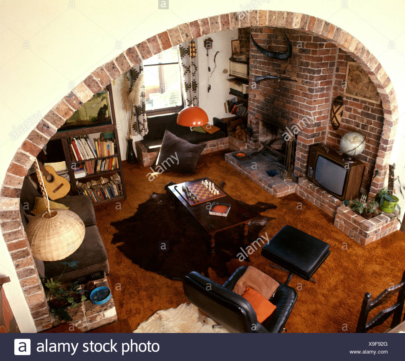 Aerial View Of Living Room Large Archway In Cream Wall Lined Bricks