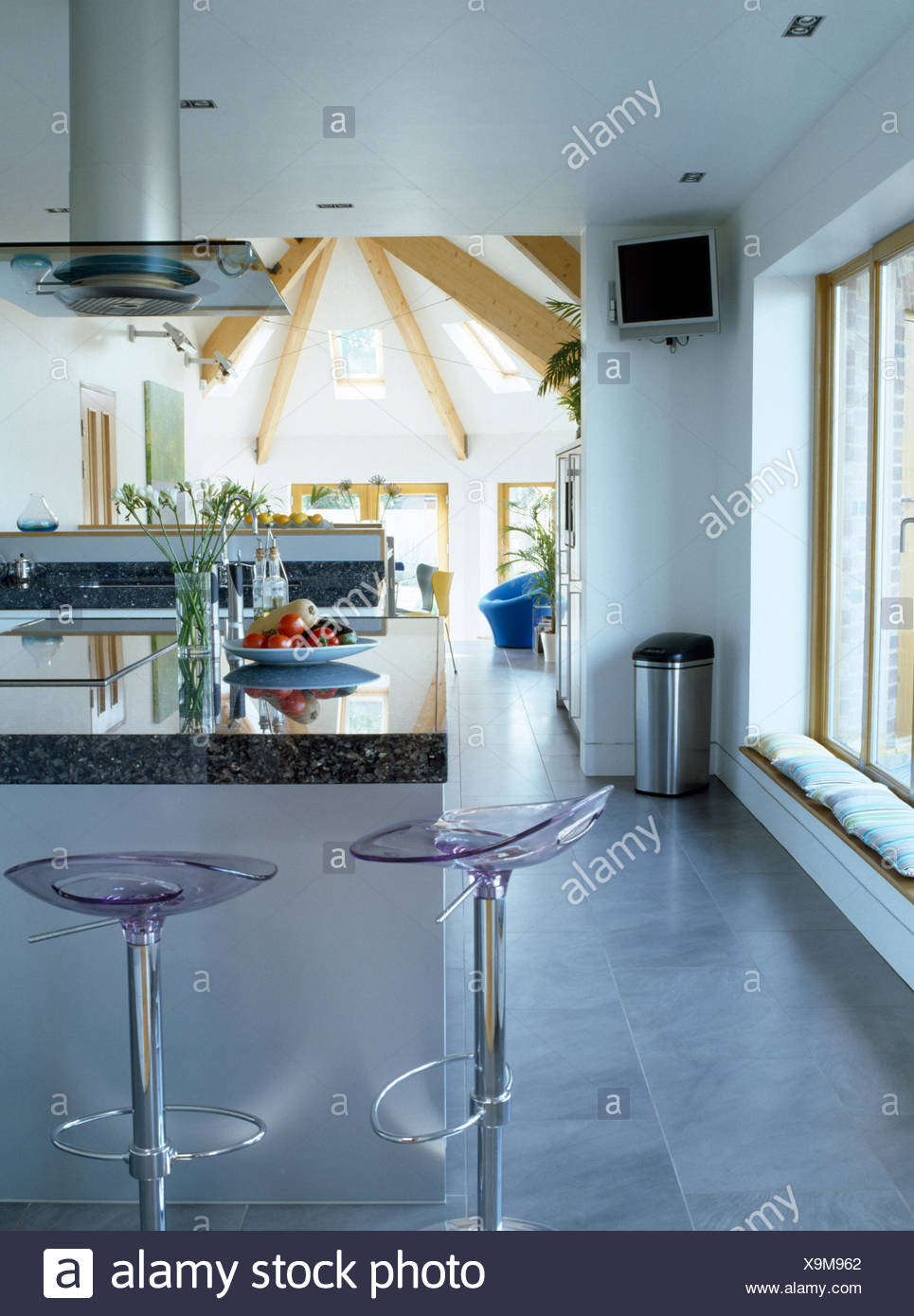Perspex+chrome stools at breakfast bar in modern open plan kitchen ...