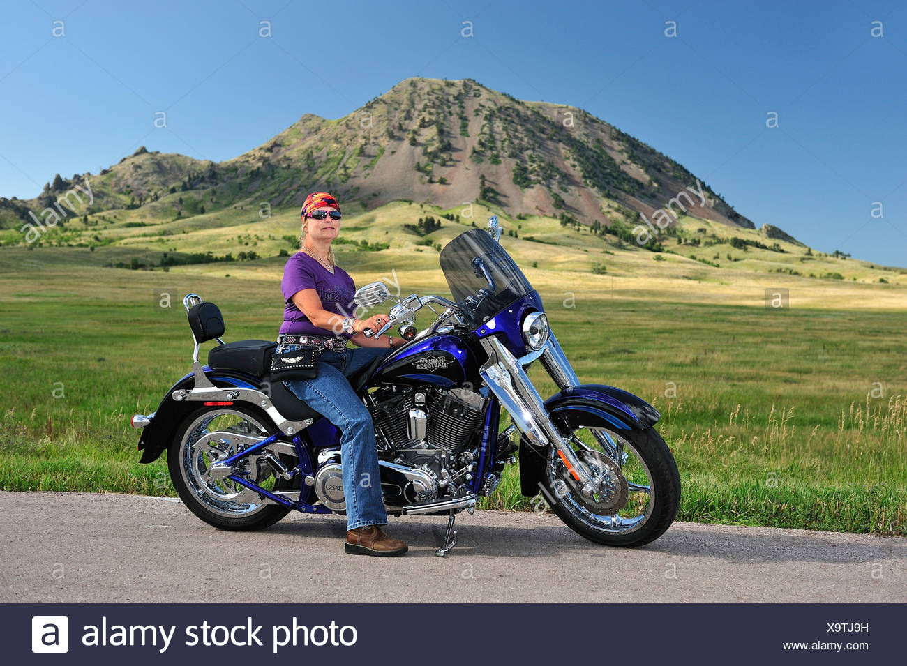 Harley woman stock photos harley woman stock images alamy for Tj motors new london