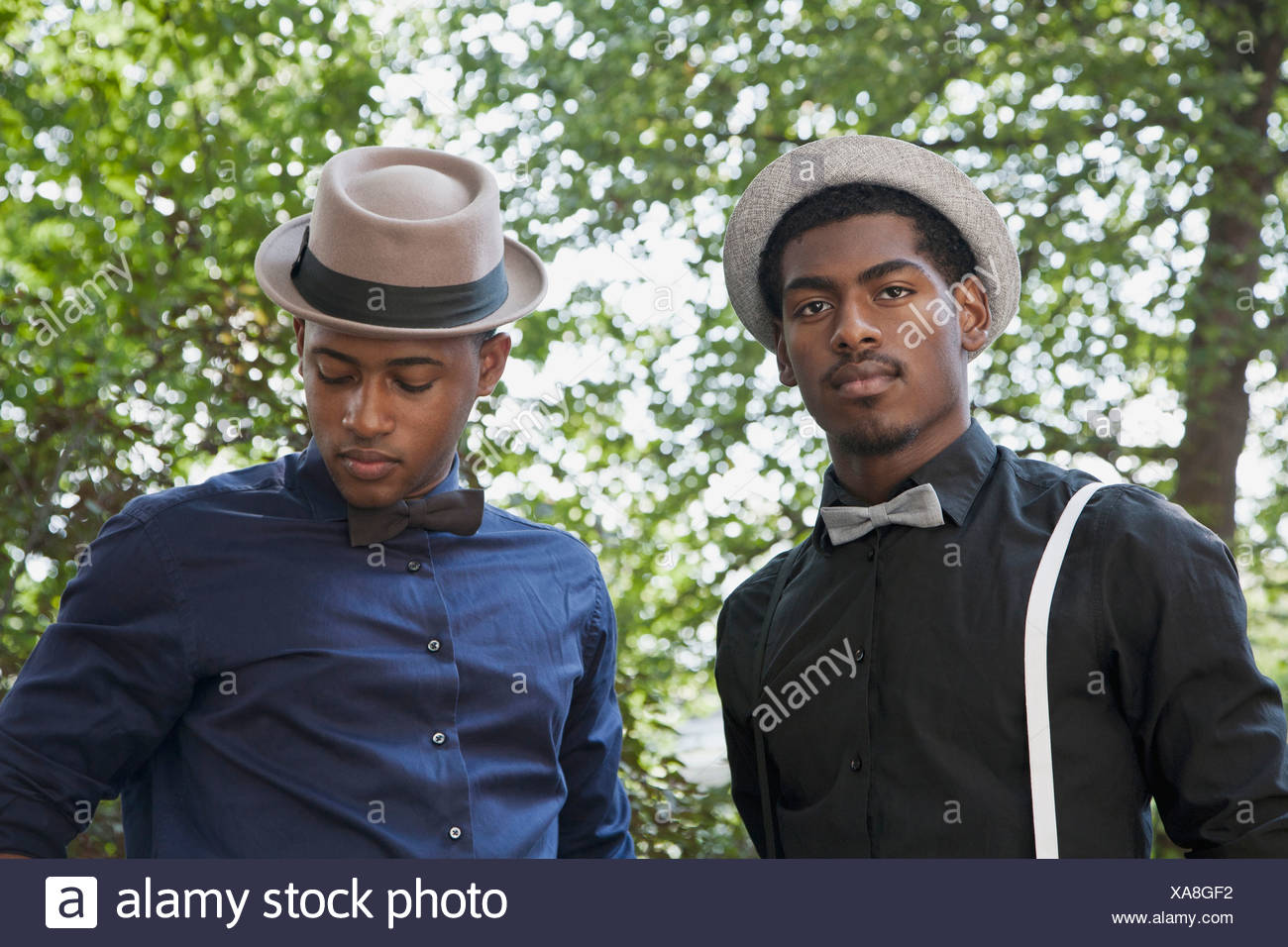 Two young black men dressed in bow ties and hats Stock Photo ... c3da44d9b213