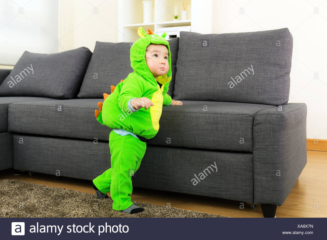 baby boy with dinosaur halloween party costume stock photo
