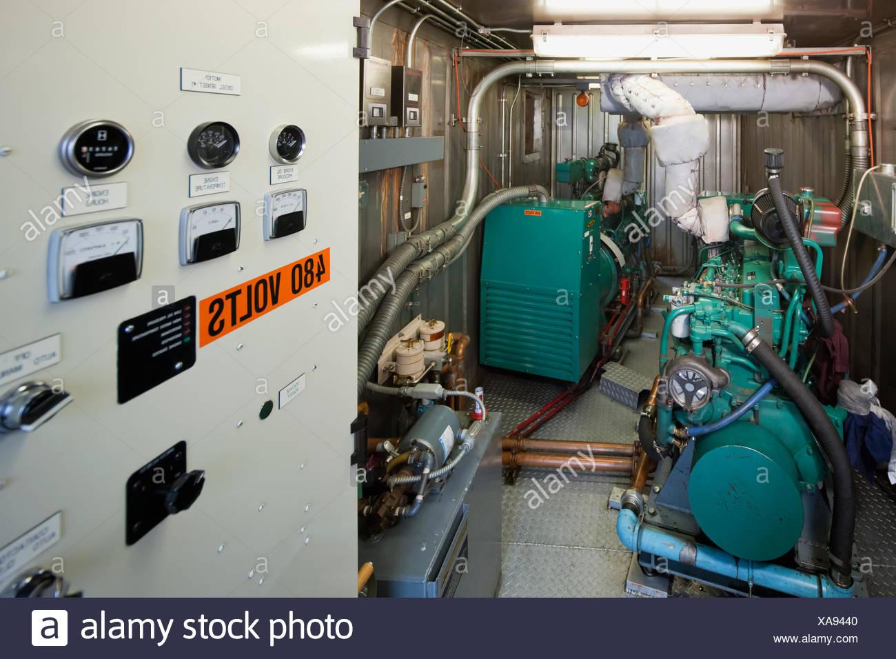 electrical power generator emergency power an indoor diesel generator and control panel electrical power plant st paul island southwestern alaska usa summer plant