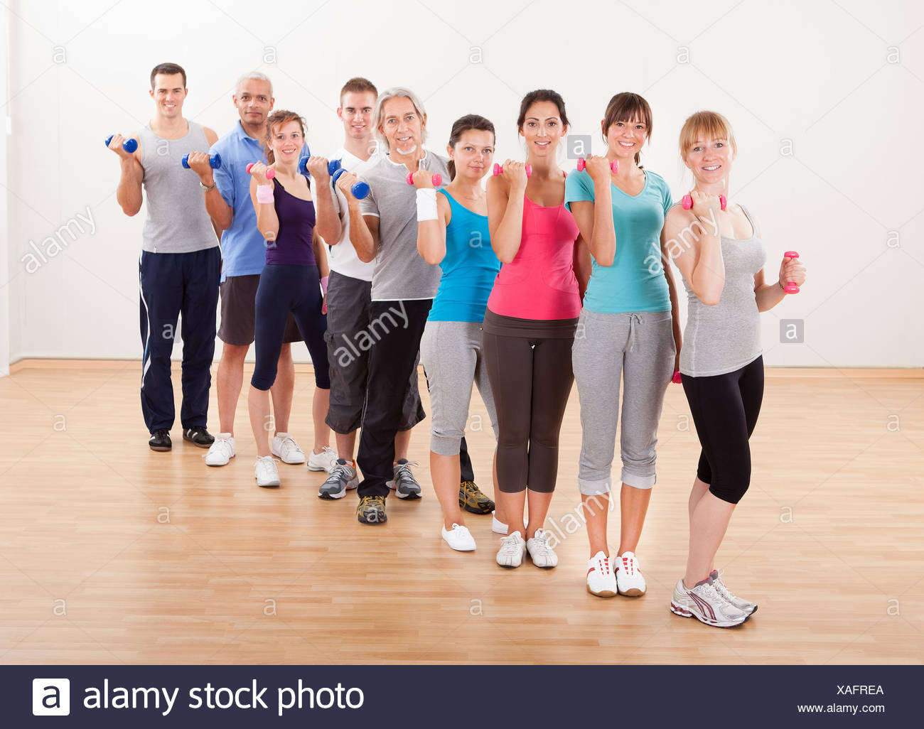 aerobics class of diverse men and women of different ages working