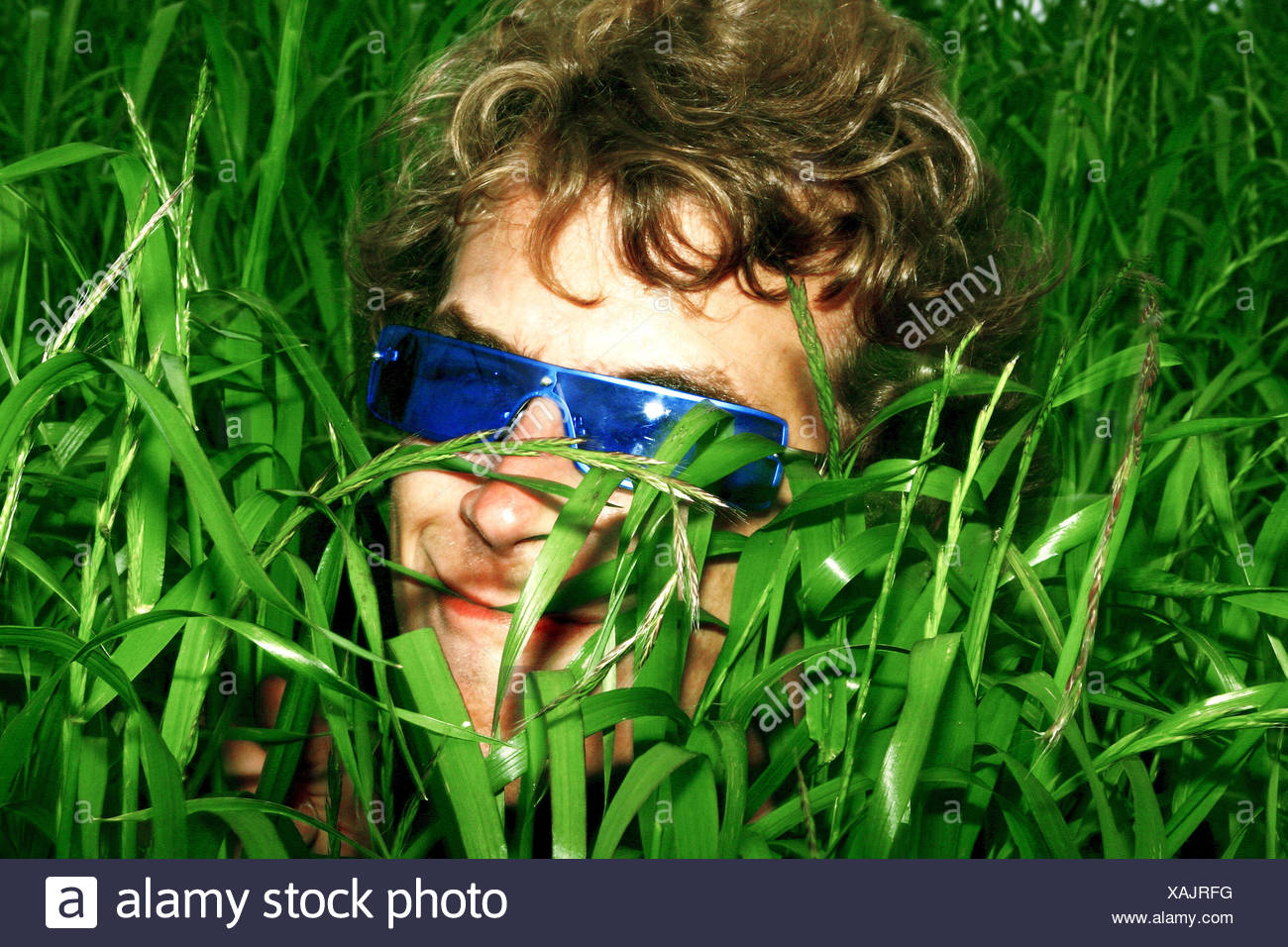 meadow grass man young sunglasses to high level views portrait