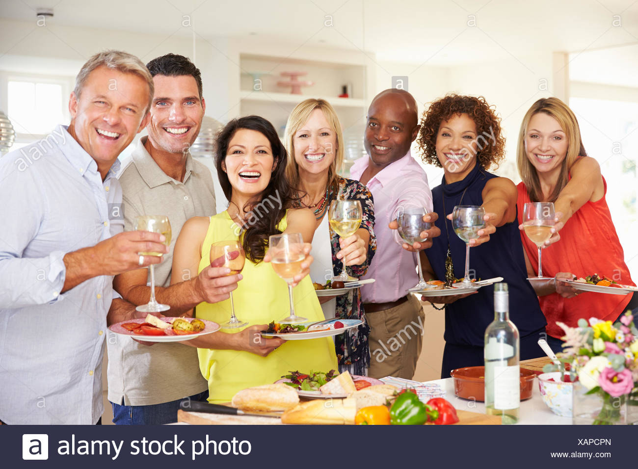 mature dinner party at home stock photos & mature dinner party at