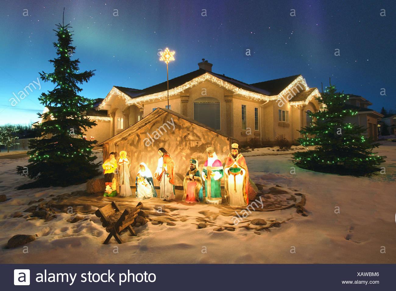 outdoor christmas nativity scene with northern lights overhead alberta canada
