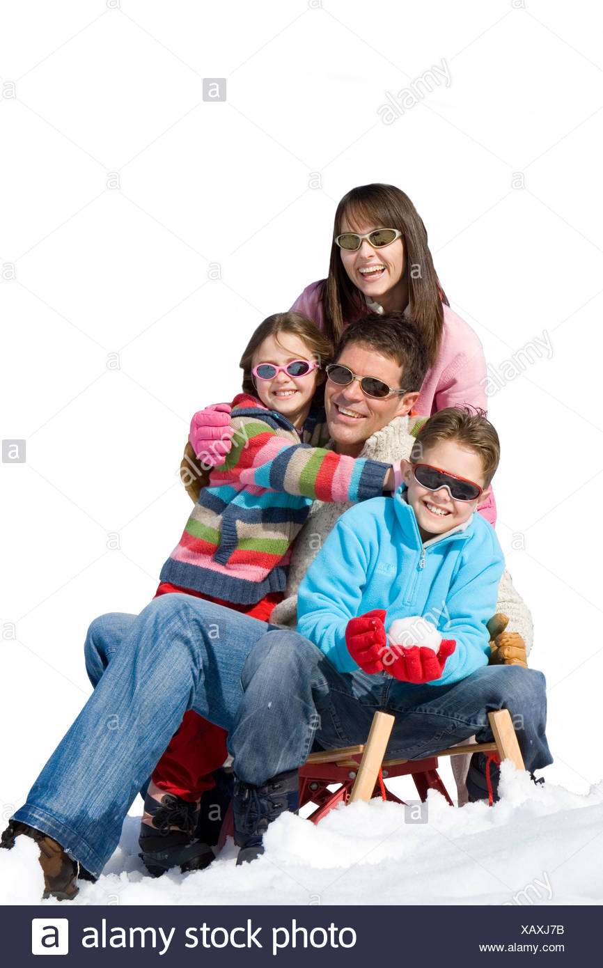 4539353c41c Couple with daughter and son on sled in snow