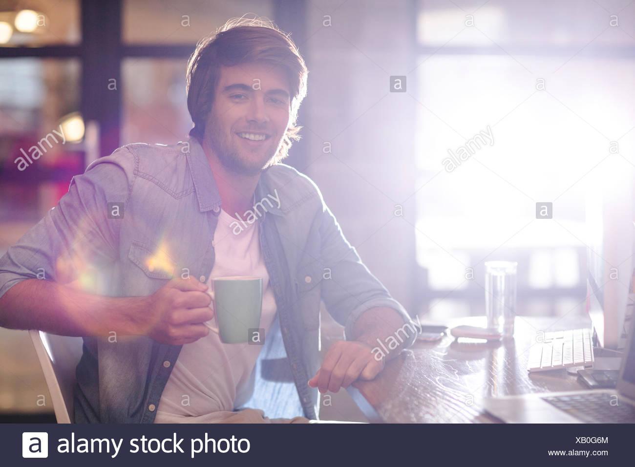 Take Break Coffeebreak : Portrait of man taking coffee break in office stock photo