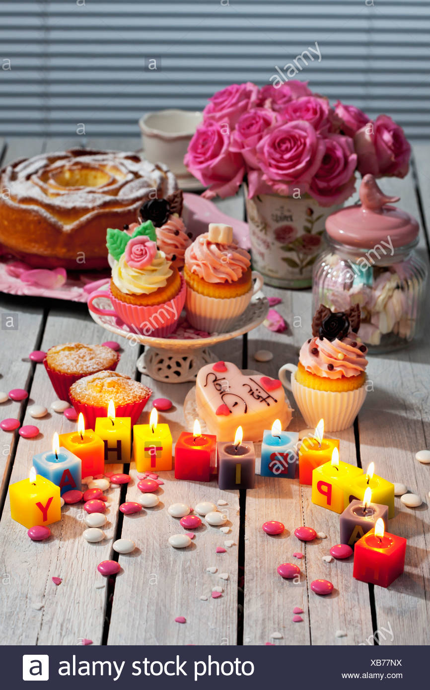 Muffins Birthday Cake Cup Cakes Roses Lighted Candles And Baking Decor On Table