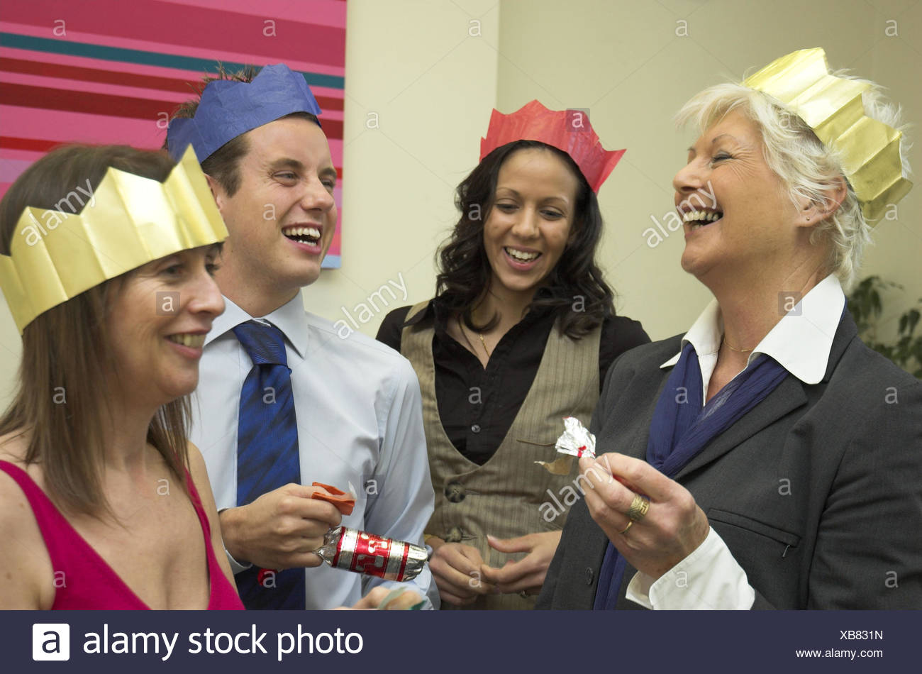 Diverse business team having fun at their office Christmas party ...