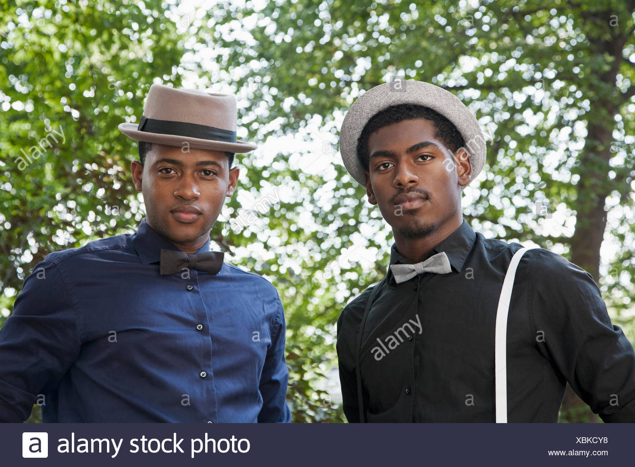 Two handsome young black men in bow ties and hats Stock Photo ... d94261e16b13